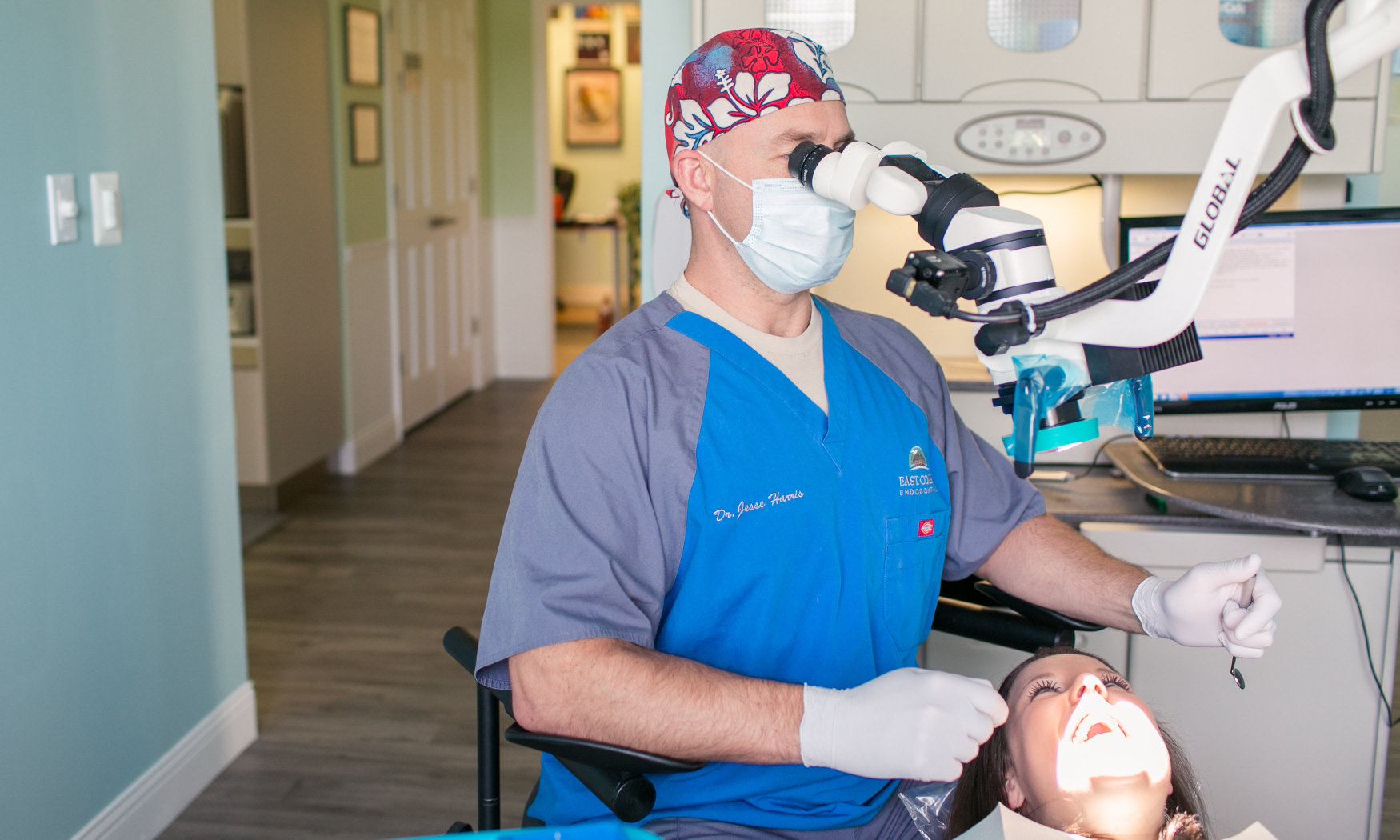 Dr. Harris performs a root canal in his office.