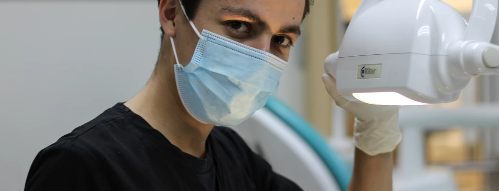 An endodontist looks at the camera before performing a root canal.